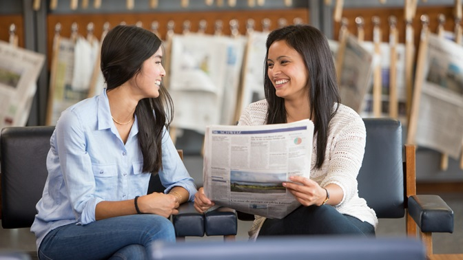 students reading a newspaper